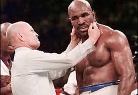 Referee inspecting Hollifields bite from Tyson